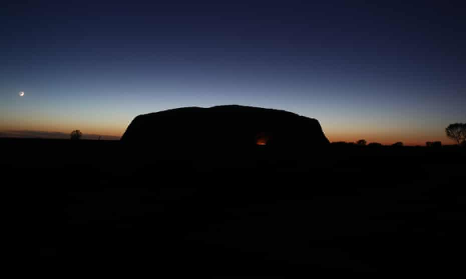 Dawn breaks at Uluru on the first full day of the climbing ban