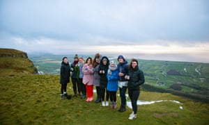 The writer and her group celebrate their activities with a mug of prosecco at the top of Binevenagh mountain, Northern Ireland.