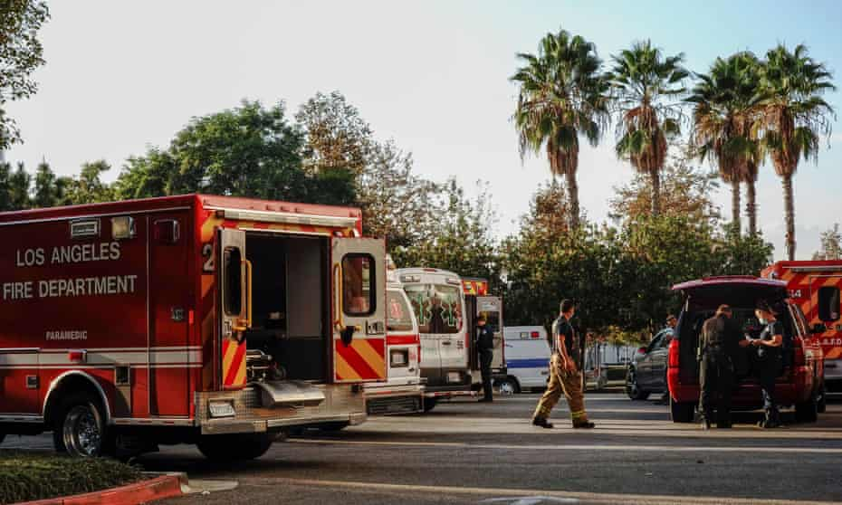 Firefighters and paramedics wait outside a hospital in Los Angeles during a surge of coronavirus cases.