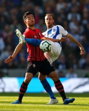 Brighton's Glenn Murray battles for possession with Southampton's Maya Yoshida at the AMEX Stadium. The Saints won the game 1-0 thanks to Pierre-Emile Hojbjerg's stike.