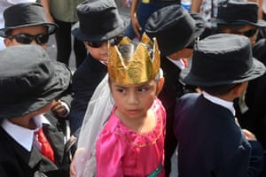Children take part in the Panchimalco flower and palm festival near San Salvador