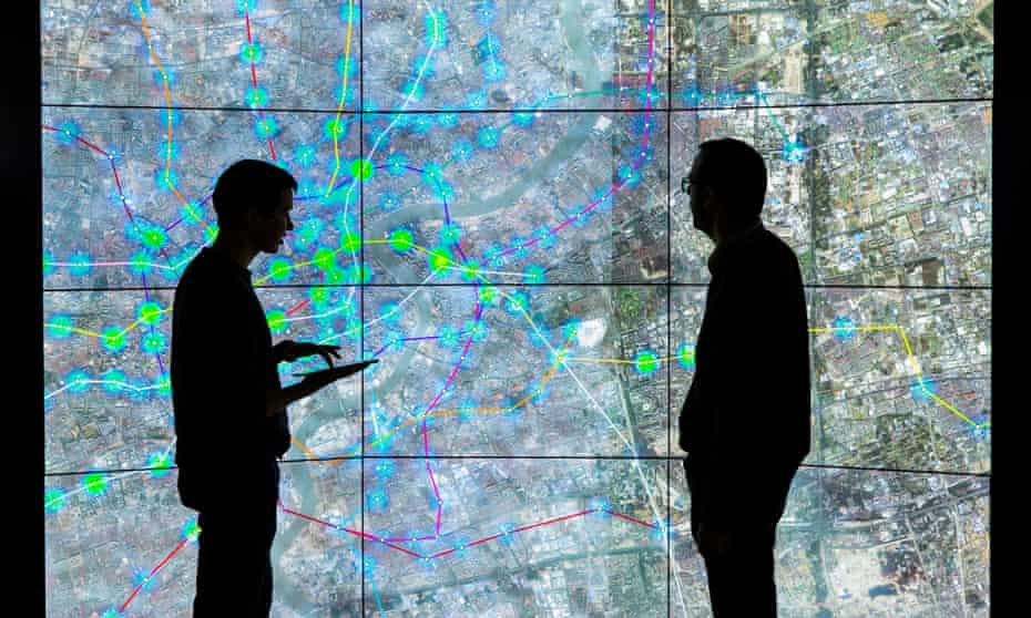 Two men look at a map of stations
