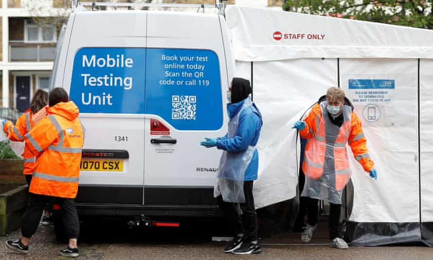 NHS workers at a mobile Covid testing unit in Tower Hamlets, London.
