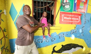 Toko and granddaughter at his bar, Paget Farm, St Vincent.