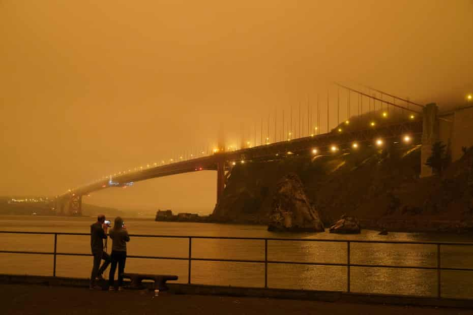 A darkened Golden Gate Bridge covered with smoke from wildfires on Wednesday.