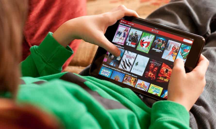 Young boy using iPad Mini