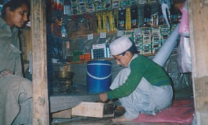 The author, aged eight, sells tailoring supplies at a bazaar.