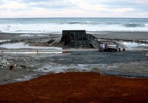 Aketo sea wall, which was damaged in the tsunami, is seen from a newly built sea wall in the village of Tanohata