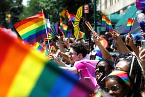 New York, US. Spectators wave flags at the 52nd annual New York City Pride parade. The theme for NYC Pride 2021 was 'the fight continues', referring to several national and local concerns, including police brutality, state anti-LGBT legislation, and economic hardship