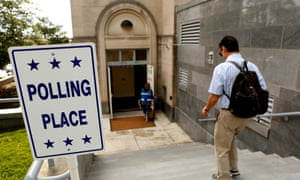 A man enters a polling station in Washington DC during the Democratic primary on 14 June 2016.