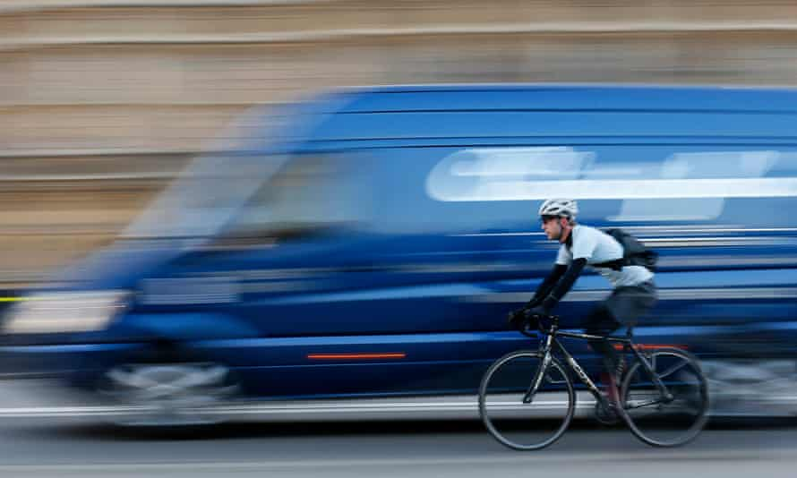 A commuter cycles in central London.