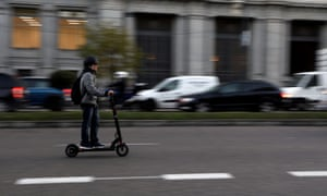 A man rides an electric scooter in Madrid, Spain. E-scooters are now available to rent in around 20 cities in 10 countries.