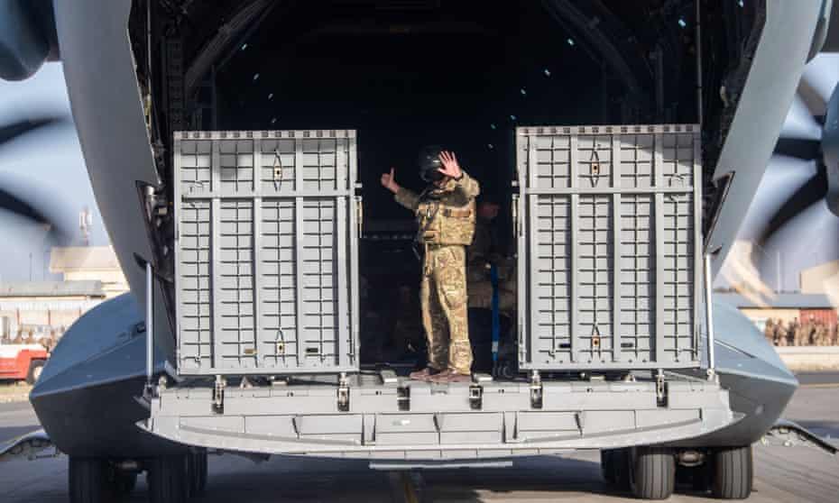 UK military on an aircraft leaving Kabul, Afghanistan.