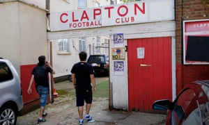 Supporters enter the Old Spotted Dog Ground, Clapton's home since 1888.