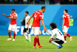 Amr Warda oh Egypt is consoled by Sergey Ignashevich of Russia.