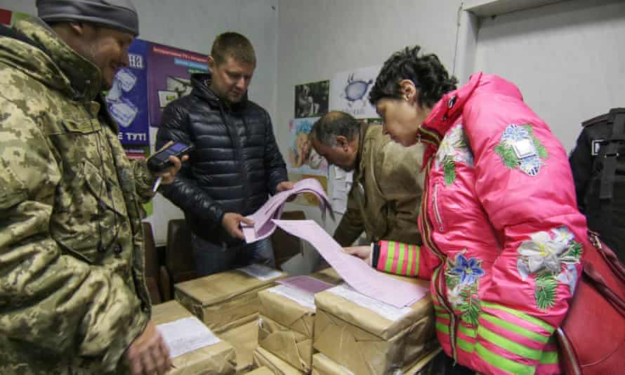Activists block the printing of election ballots in Mariupol