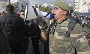 A soldier in Algiers voices support for the election