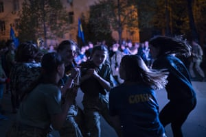 Members of Sokil, the youth wing of the nationalist Svoboda party, dance during a concert in Kiev