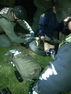Dzhokhar Tsarnaev, 19, is searched by law enforcement officers after his capture in Watertown.
