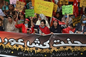 Trade union members take part in a march in Lahore, Pakistan