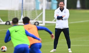 Frank Lampard keeps an eye on Chelsea's training session at Cobham on Tuesday.