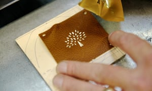 Undated photo of the Mulberry logo being applied in their factory in Somerset.