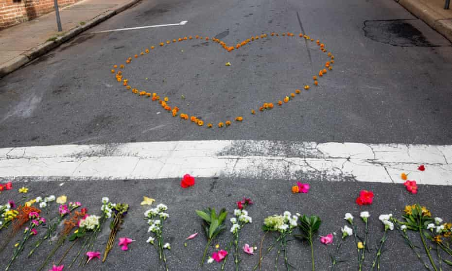 A heart shaped group of flowers placed at the corner of Fourth Street and Water Street, where Heather Heyer was murdered by white supremacist James Fields at the Unite the Right rally in Charlottesville, Virginia, on 12 August 2017.