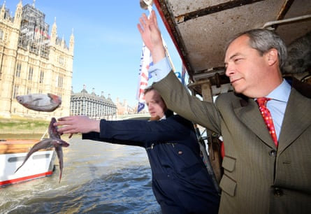 Nigel Farage and the founder of Fishing for Leave, Aaron Brown, symbolically dumping fish next to the Houses of Parliament.