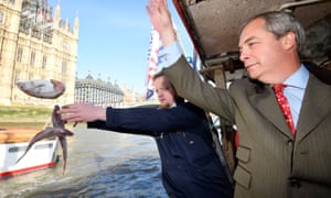 So long, and thanks for all the fish: Nigel Farage and the founder of Fishing for Leave discard fish next to the Houses of Parliament.