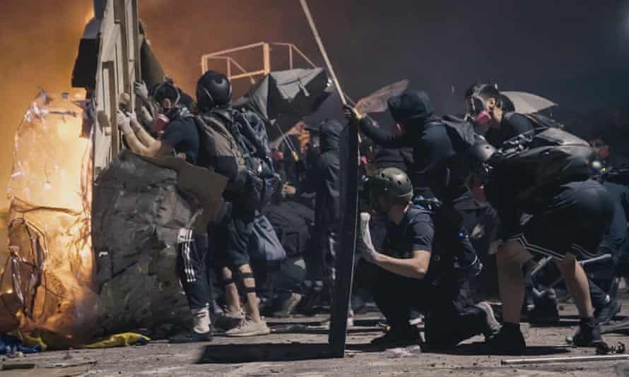 Pitched battles … student demonstrators face off against riot police at the Chinese University of Hong Kong in Cockroach.