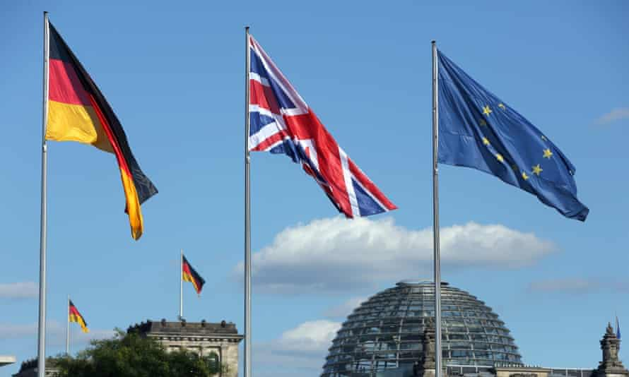 German, British and EU flags fly in Berlin, where Theresa May was visiting