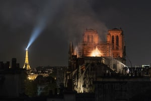 Smoke and flames rise from Notre Dame Cathedral following a devastating fire that quickly spread across the building and brought the spire to collapse. 15 April, 2019