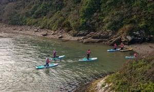 Gutsy Girls paddleboarding in Cornwall