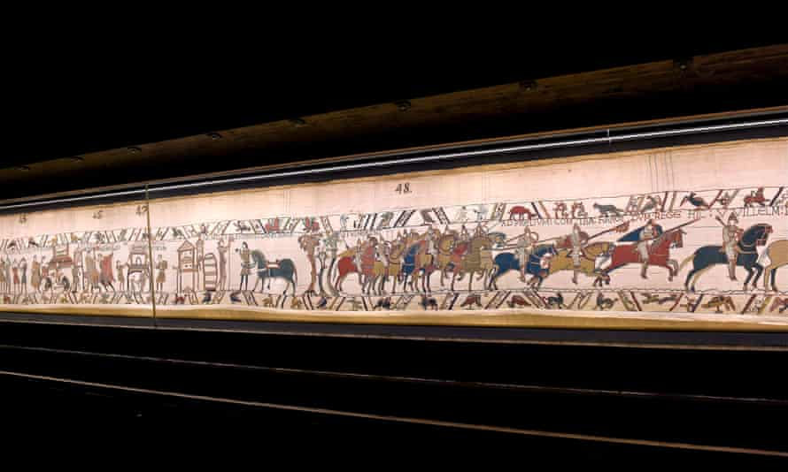 The Bayeux Tapestry, which depicts the Battle of Hastings on display at Bayeux Town Hall.