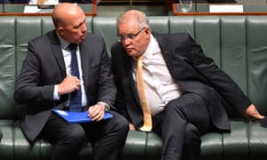 Minister for Home Affairs Peter Dutton and Prime Minister Scott Morrison during a motion to suspend standing orders calling for government intervention for the dairy industry in the House of Representatives at Parliament House in Canberra, February 20, 2019.