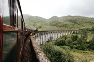 A train weaves through highland scenery on the Isle of Skye