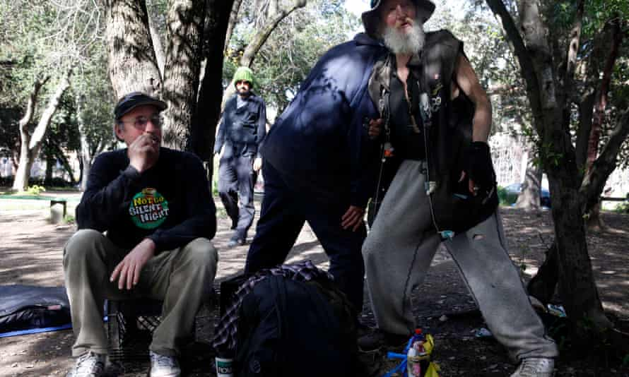 Ace Backwords (left) smokes a cigarette next to his longtime friend the 'Hate Man' in People's Park, Berkeley.