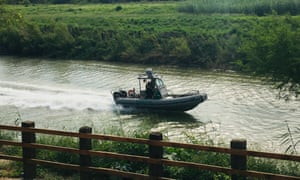 A US border patrol boat navigates the Rio Grande near where the bodies of migrant Oscar Alberto Martínez Ramírez and his daughter Valeria were found, in Matamoros, Mexico, on 24 June.
