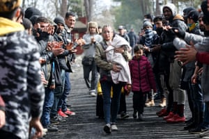 Asylum-seekers, waiting at Turkey's Pazarkule border crossing to reach Europe, stage a demonstration at the buffer zone demanding to open the gate