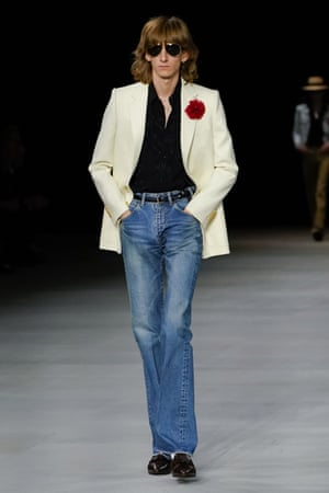 Celine: If it wasn't already clear before the designer Hedi Slimane came out all smiles for a post-show bow, his second men's collection for the house was a hit. Far from being dominated by his signature suiting, it was full of elevated casualwear inspired by the 70s. Flared jeans and bomber jackets, open-neck suiting (a la Saturday Night Fever), basket bags and plenty of embroidery, Slimane painted an attractive picture of the cool crowd come 2020. On the model's feet were Converse, woven sandals and jelly shoes. This was relaxed confidence, which suits Slimane and the house.