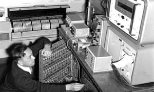 Dr Shizuo Ishiguro with his electronic analogue machine, which converted meteorological and ocean data into electrical signals on a series of wire meshes. This allowed the height of storm surges, and where and when they would make coastal impact, to be predicted.