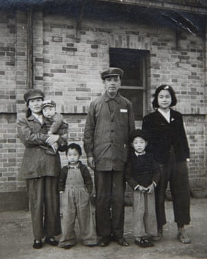 Zhang Xizhen (R4) poses with her family on the first half of the year 1949 in Beijing, China.