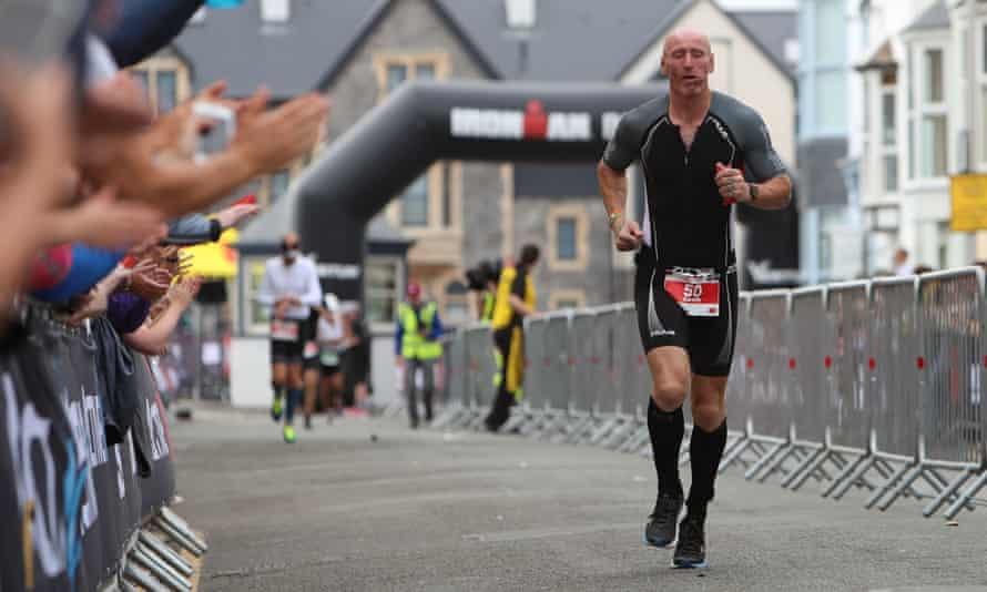 Gareth Thomas competes in a triathlon