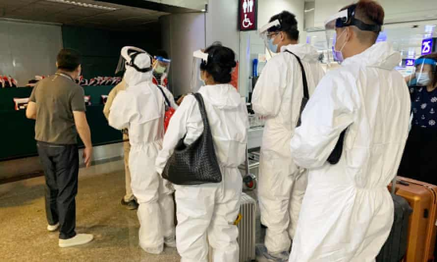 Travellers board flights from Taipei