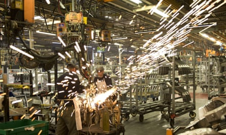 Nissan's manufacturing staff weld vehicle panels at the company's Sunderland plant.