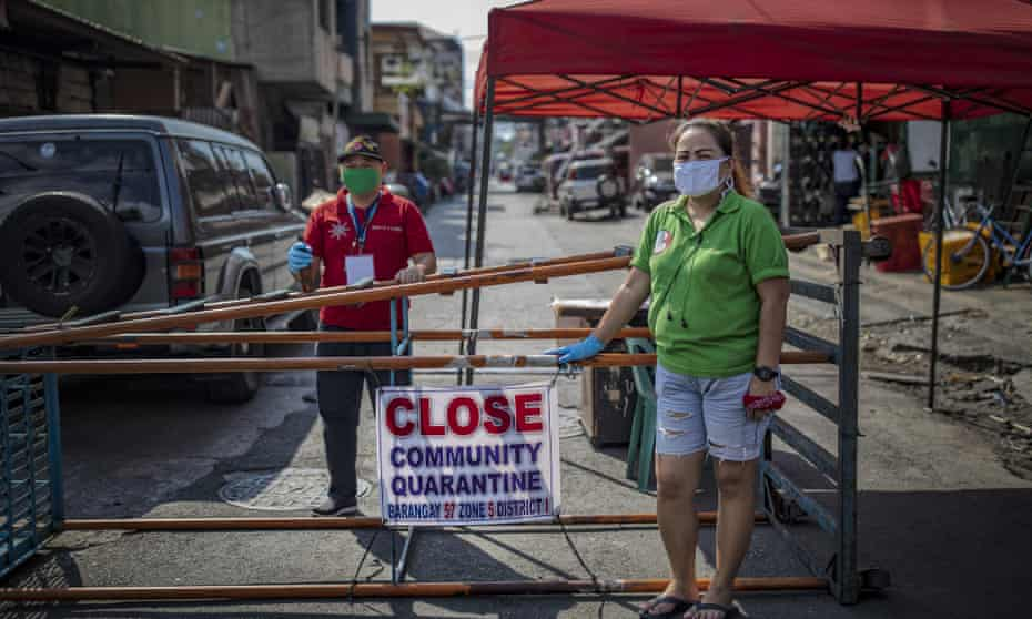 Residents of Manila's poorer districts have begun putting up makeshift barricades to halt movement amid the coronavirus crisis