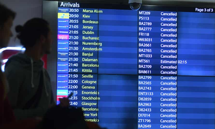 The arrivals board at Gatwick airport displays scores of cancelled flights