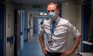 NHS chief, Sir Simon Stevens in a hospital ward