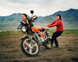Mongolian girls on a Chinese-made motorbike