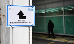 A sign points the way to a 'coronavirus pod' at a hospital in London